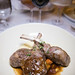 Grilled lamb chops, polenta, root vegetables, rosemary sauce with a glass of Colomé Malbec