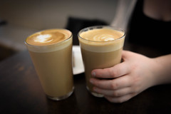 Hand Holding Glass of Coffee Latte