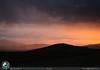 Acquazzone illuminato dal tramonto