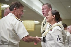 Adm. John C. Aquilino, commander of U.S. Pacific Fleet, congratulates Logistics Specialist 1st Class Sindy Johnson and Interior Communications Electrician 1st Class Nicholas Natelli following the ceremony announcing their selection as Sailors of the Year for Pacific Fleet. (U.S. Navy/MC1 Nathan Laird)