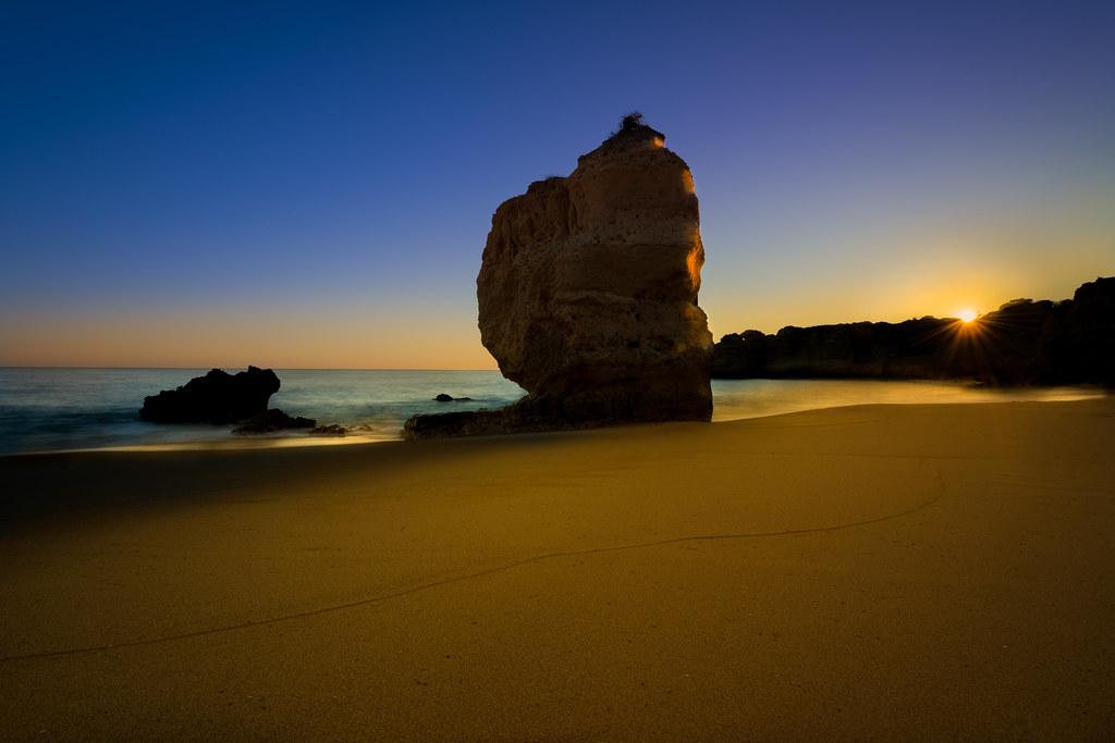 Sunset Silhouette At Praia De São Rafael, Algarve, Portugal