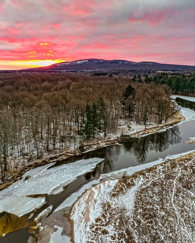 mountain mountains sunrise sunrises sky clouds art new old winter snow water ice cold pink tree trees forest woods park wausau wisconsin midwest nature landscape dji mavic 2 pro drone uav northwoods north up home fun shadows reflections frozen outside outdoors white light sun cloud yellow river orange explore adventure travel