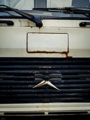 Broken Mercedes star on an old truck