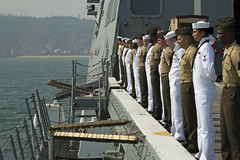 Sailors and Marines man the rails aboard USS Anchorage (LPD 23) while arriving in Visakhapatnam. (U.S. Marine Corps/Sgt. Victoria Decker)