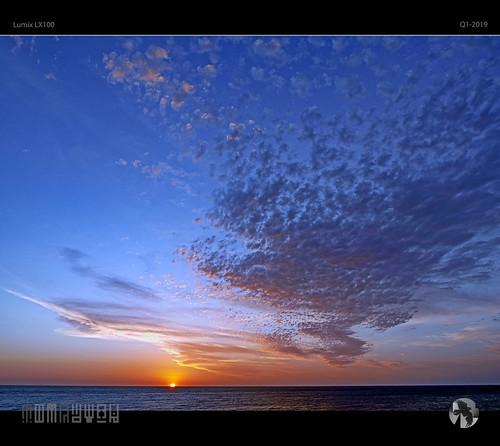 sky sunset clouds sun aravenimage tomraven bigsky speckled cloud sea ocean seascape q12019 lumix lx100