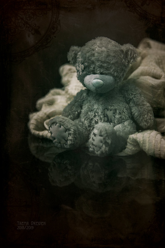 A teddy-bear in the Victorian style