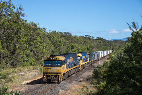 Pacific National NR98/105/G528 passes Hungry Head Rd on 1BS3 from Brisbane to Sydney