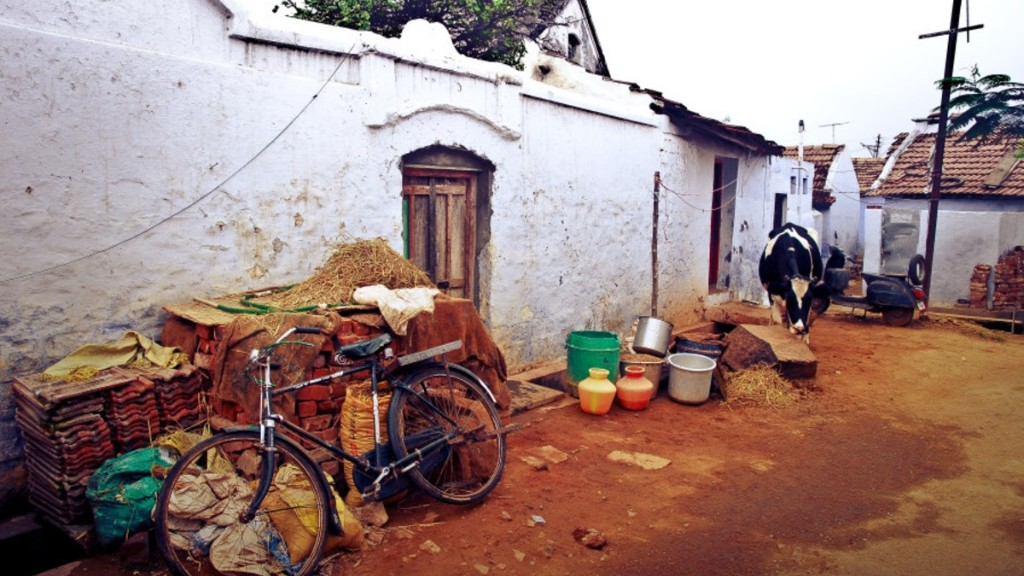Bicycle and scooter outside a house in Coimbatore, India