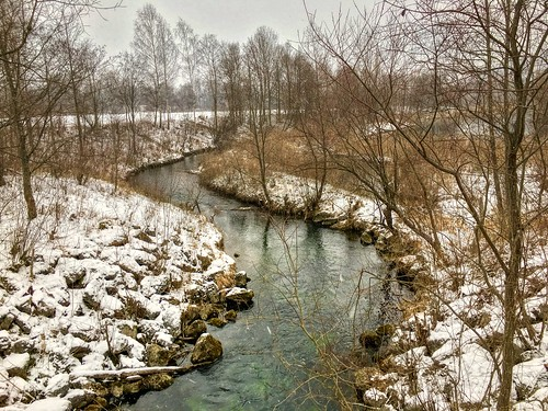 Brook in winter by the river Inn near Oberaudorf, Bavaria, Germany