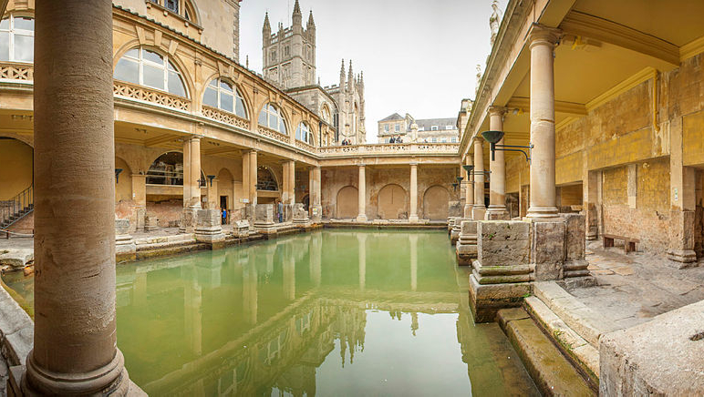 Roman Baths hot springs with Bath Abbey in the background