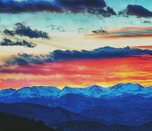 colorado coloradoclouds snow sunset rockymountains peak winter cloudy