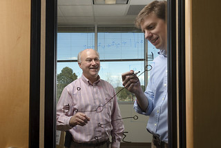 Gary Grider, left, and Brad Settlemyer discuss the new LANL and Carnegie Mellon software product, DeltaFS, released to the software distribution site GitHub this week.