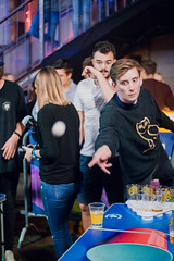 Beer pong player throwing the ball