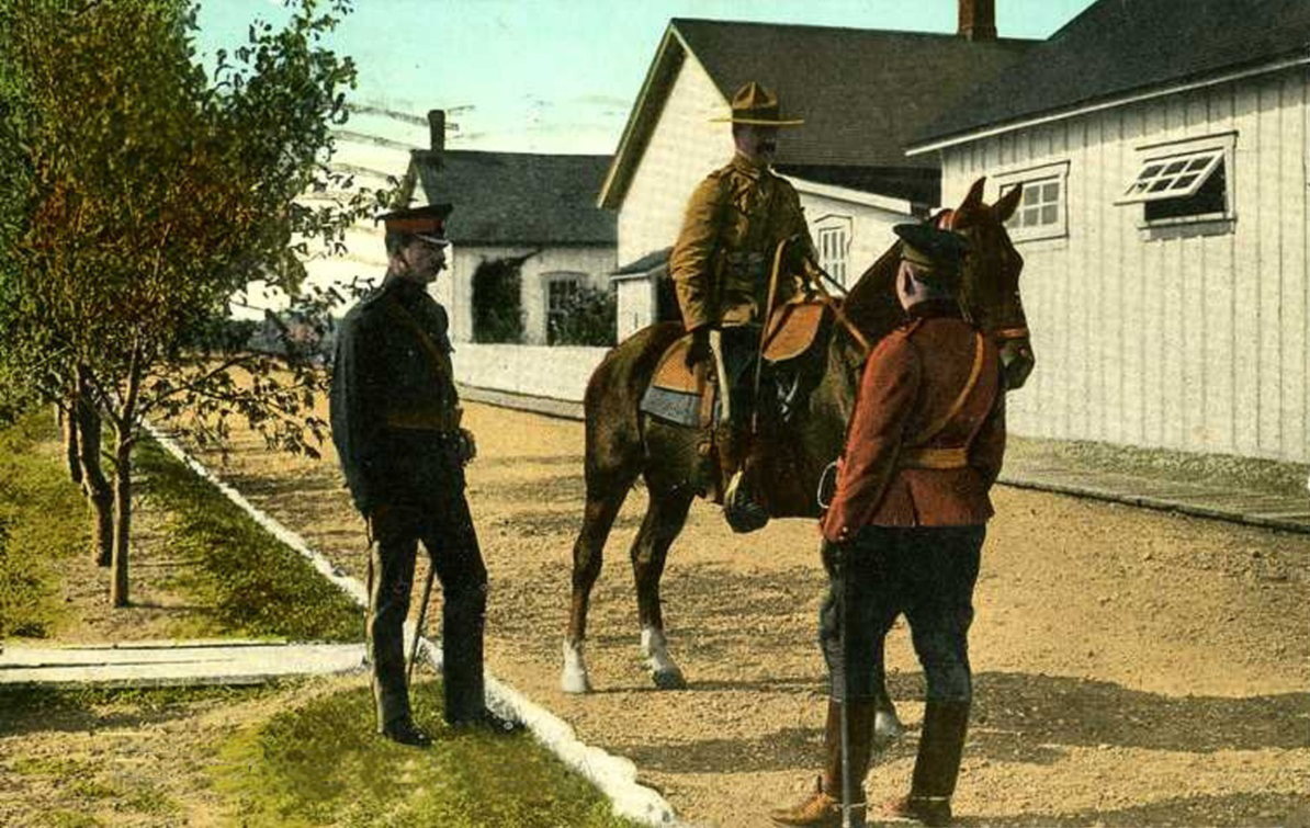 Postcard of Royal North West Mounted Police officers at the Macleod, Alberta barracks, 1910s.
