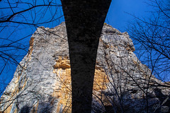"Extreme upward capture of the Kókkoris's or Noutsos's bridge in central Zagori, Greece.  The arched bridge was built in 1750 and is located near the Kipoi (Kēpoe, Κῆποι) village. It is 23.6 m (77 ft) long, 13 m (43 ft) high and spans the Vikakēs or Voïdomátēs river.   Kēpoe is one of the 46 Zagóri villages or Zagorochória. They are all built in high altitude, on Pindus range of mountains, in northwestern Greece. Zagori is an area of great natural beauty, with striking geology and two National Parks (one including the river Aōos and the Vikos Gorge, the other around Valia Kalda, to the east of the imposing snow-capped Mt Tymphē).  The Upward capture of this photograph reminds of the following lines from the most poetic of all the works Albert Camus wrote for the stage:  ""…here, where the gaze is stopped everywhere, the Whole Earth Is Designed so that the Face Turns Upward and the gaze implores. Oh! I hate this world where we are reduced to God.""  —Albert Camus (The Misunderstanding - Le Malentendu, act.2)"