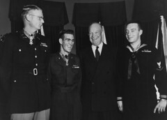 President Dwight D. Eisenhower poses with three men at White House in 1954, to whom he has just presented the Medal of Honor for conspicuous gallantry in Korean War combat action, including Hospital Corpsman 3rd Class William R. Charette. (Naval History and Heritage Command)