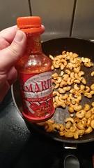 spicy cashews made with marie's kambuzi hot sauce