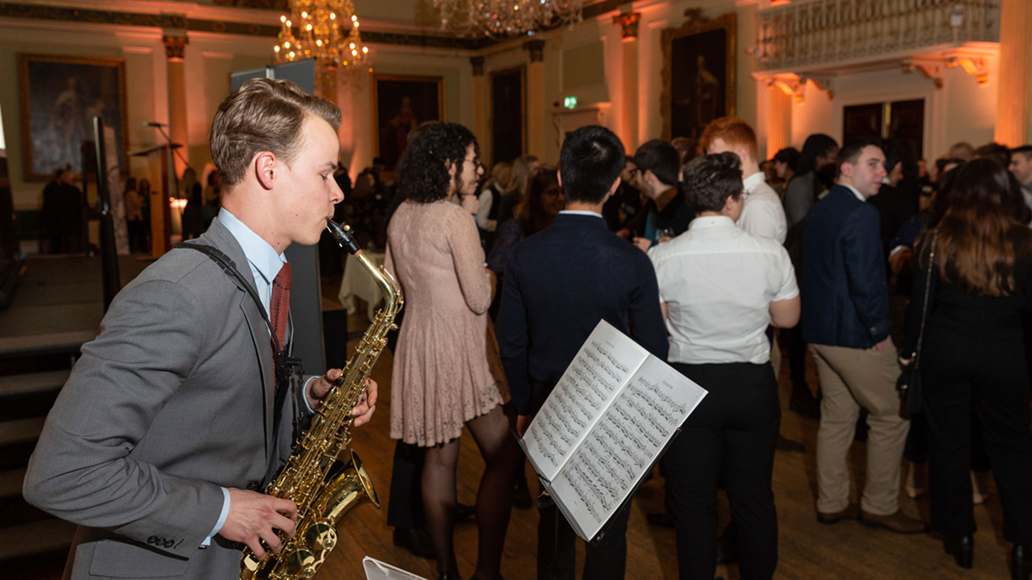 Santander Arts Scholar, Bas Lodewijks, playing saxophone in the Guildhall