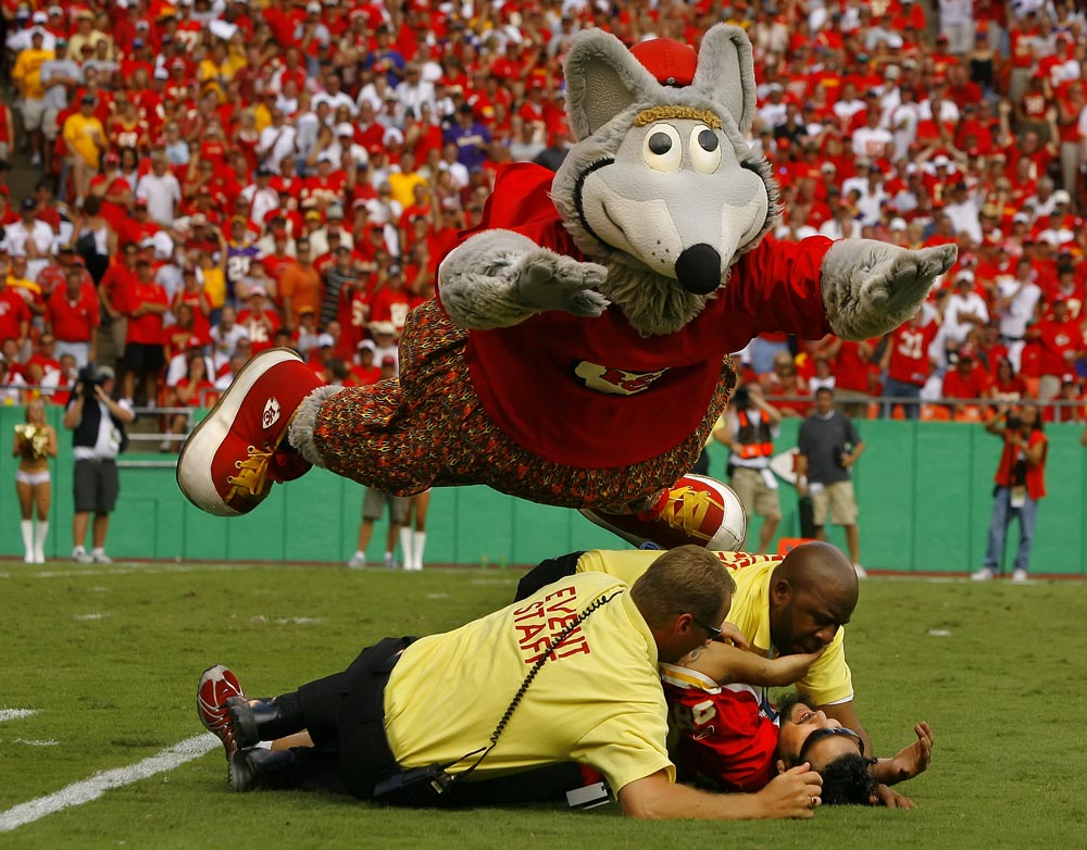 Kansas City Chiefs mascot KC Wolf helped out security guards by diving on a fan that ran out onto the field during the game against the Minnesota Vikings Sunday, September 23, 2007, at the Chiefs home opener at Arrowhead Stadium. The fan was arrested and the Chiefs won 13-10 for their first victory of the season. DAVID EULITT/The Kansas City Star--09232007--CHIEFS VIKINGS--