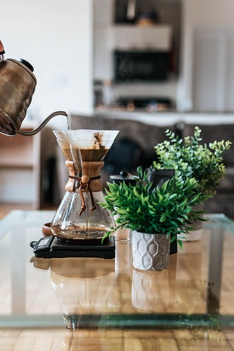 person pouring coffee ion jar - Credit to https://myfriendscoffee.com/