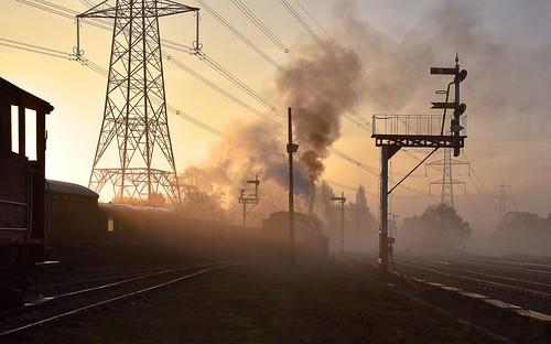 greatcentralrailway trains railway loco steam thelasthurrah endofseasongala locomotive locos engine smoke power track trucks freight goods sunrise pylon semaphore signal gantry