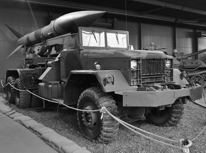A truck with a missile positioned on top of it.