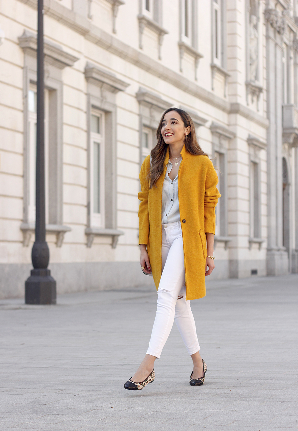 mustard coat ripped white jeans leopard flats calvin klein bag street style outfit 20197