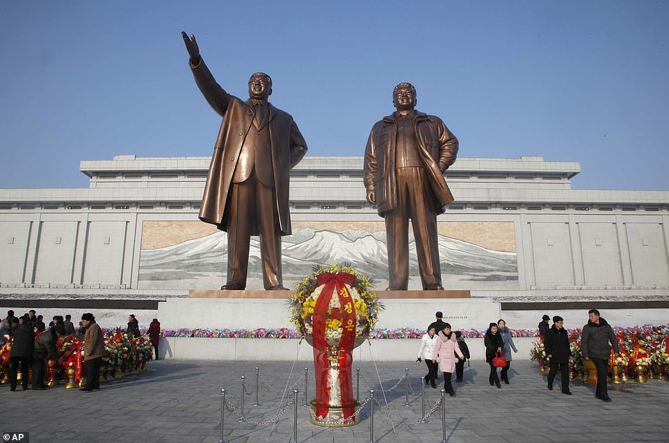North Koreans visit the statues of former Supreme Leaders Kim il-sung (left) and Kim Jong-il (right) on Mansu Hill, Pyongyang. Associated Press photo taken on February 16, 2019.
