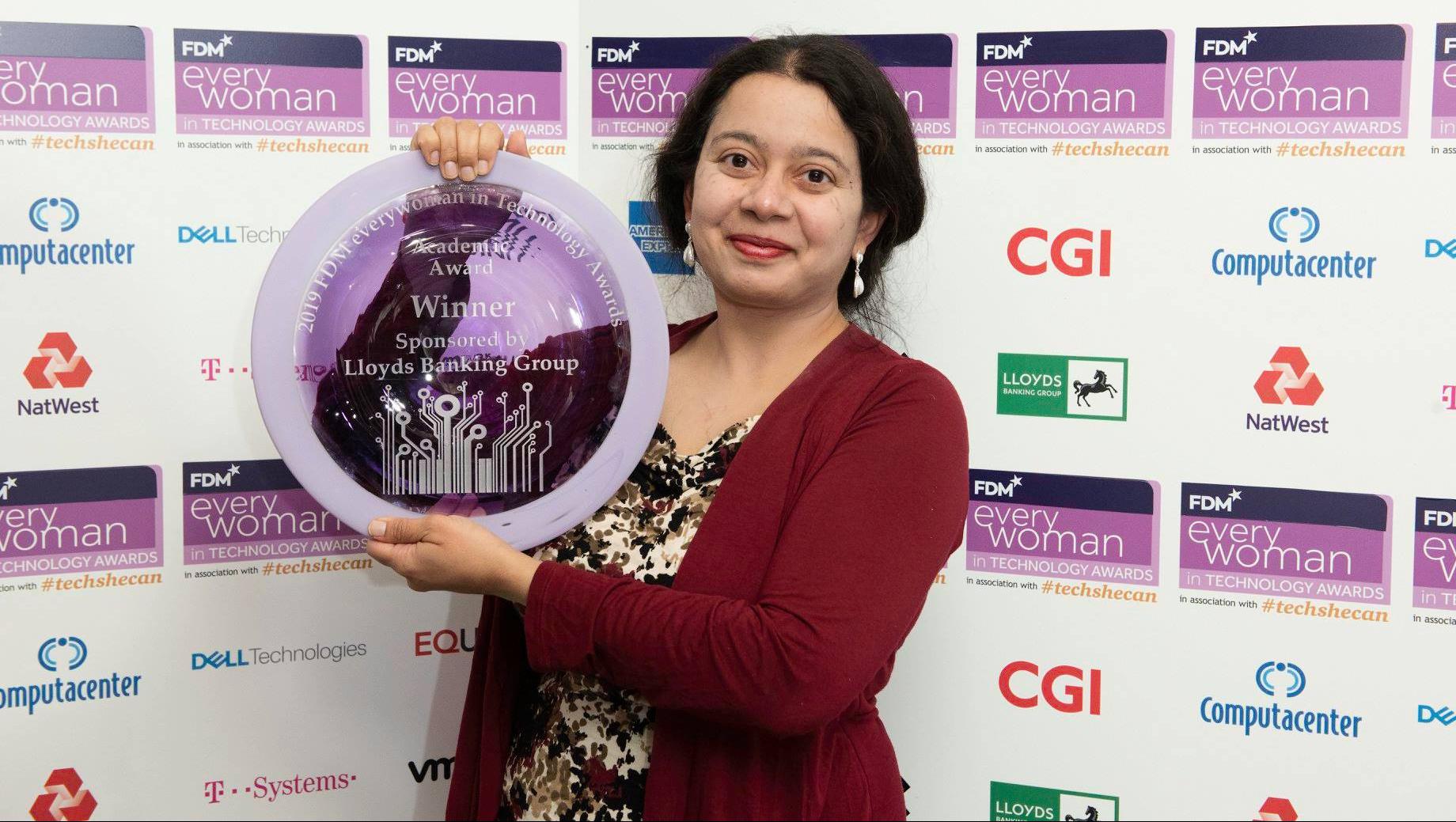 Dr Apala Majumdar with her award