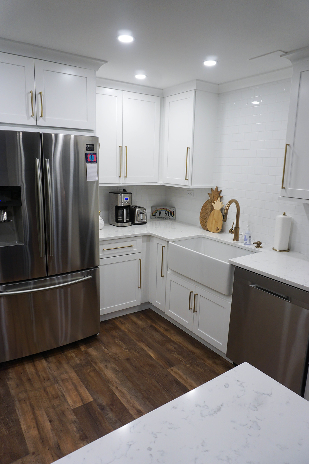 Stainless Steel Appliances White Farmhouse Sink White Cabinets Top Knobs Honey Bronze Handles