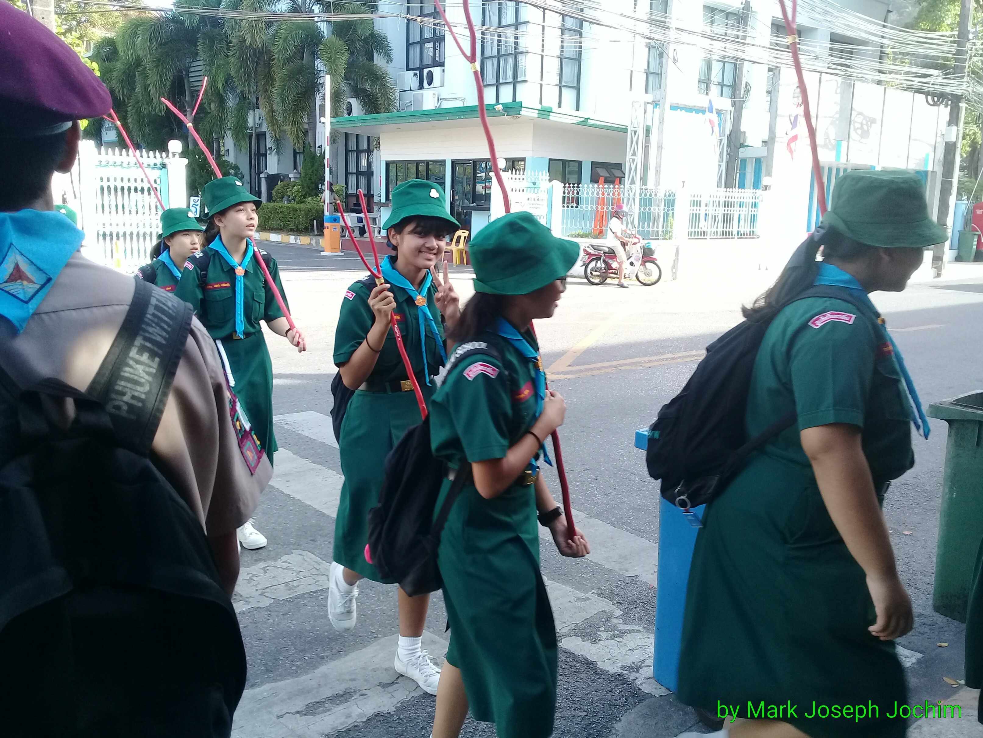 A parade of Scouts outside Phuket Witthayalai School early Saturday morning.
