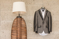 Groom's Suit hanging next to a lamp