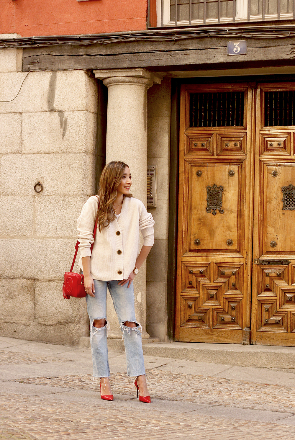 beige cardigan gucci bag red heels ripped jeans street style outfit 20195