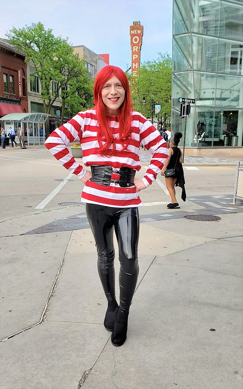 Red hair, candystripe shirt, and vinyl leggings
