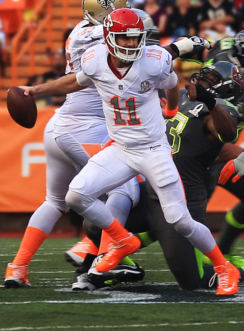Alex Smith, quarterback for the Kansas City Chiefs, evades being tackled in an attempt to throw a pass down the field during the 2014 National Football League Pro Bowl at Aloha Stadium, Hawaii, January 26, 2014. Photo taken by Lance Cpl. Matthew Bragg, U.S. Marine Corps.