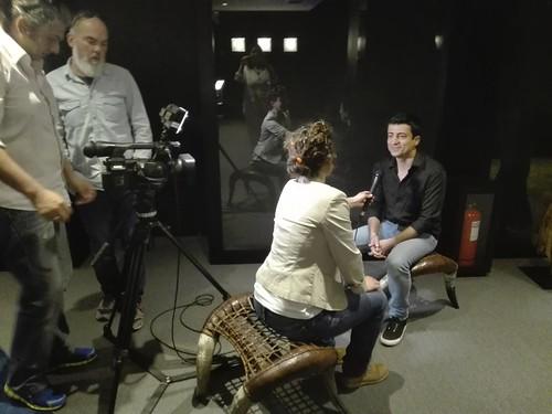 Interviewer interviewing man and two cameramen
