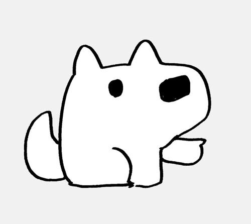 指を指す白犬