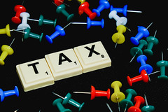 Tax text on black background