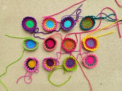 Twelve future boho squares for a crochet purse