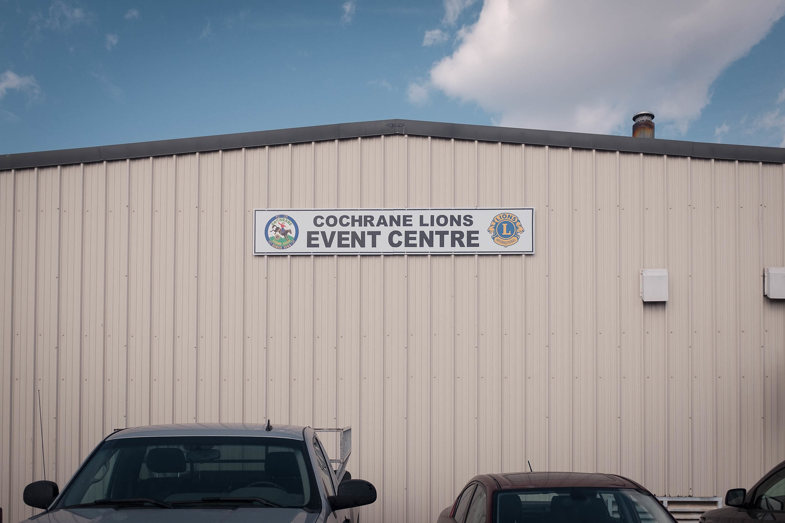 Sign on warehouse reading Cochrand Lions Event Center