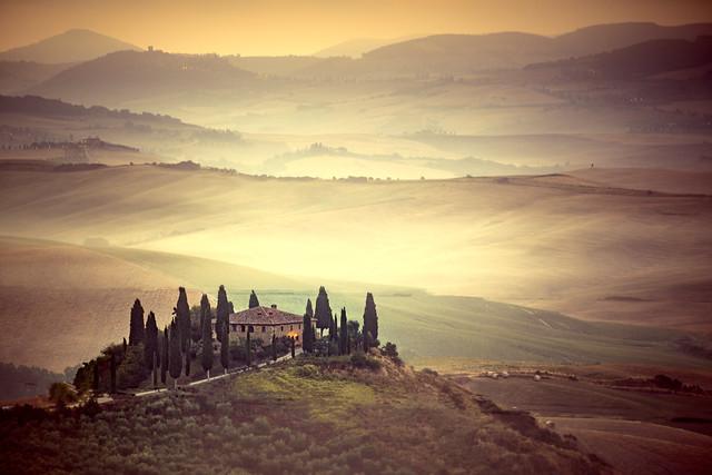 farmhouse, mist and cypress trees