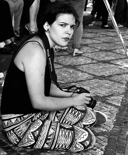A Photographer woman not very happy to be photographed