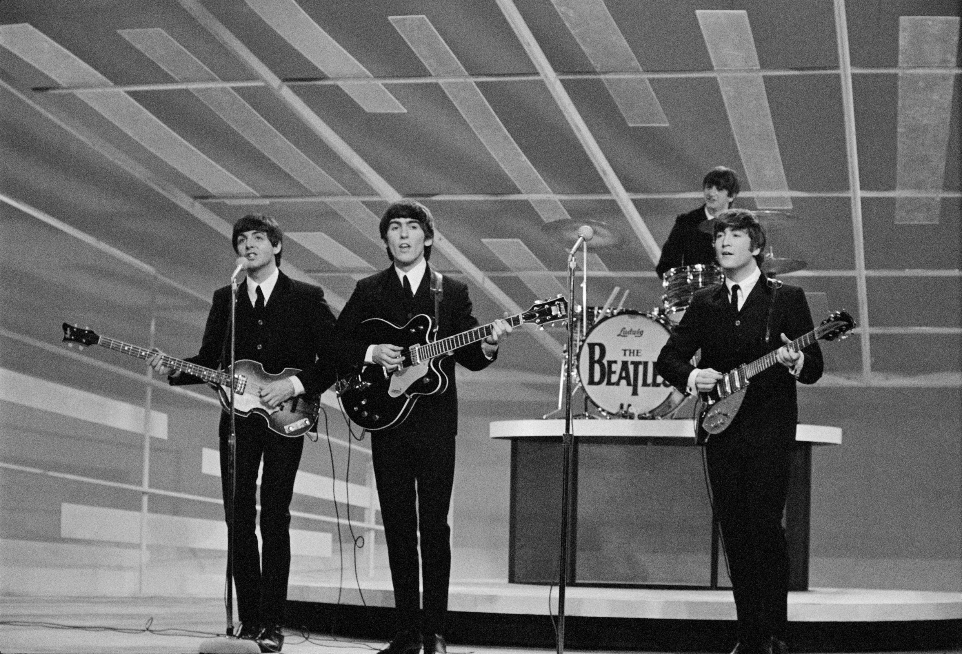 NEW YORK - FEBRUARY 9: The Beatles perform during their first appearance on THE ED SULLIVAN SHOW, February 9, 1964. From left: Paul McCartney, George Harrison, Ringo Starr, and John Lennon. (Photo by CBS via Getty Images)