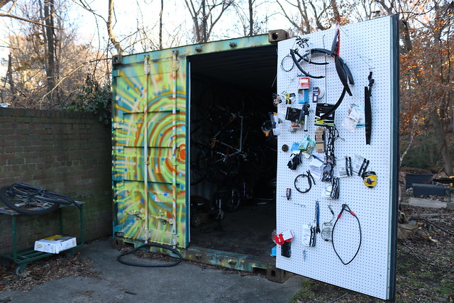 A photo of a storage pod with tools and bicycles.