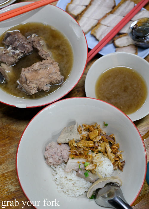 Dry boiled rice with pork and soup and boiled pork ribs at Go-Benz in Phuket Thailand