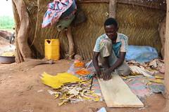 Boy making wallet - Leah Eaton, ACDI/VOCA, Burkina Faso