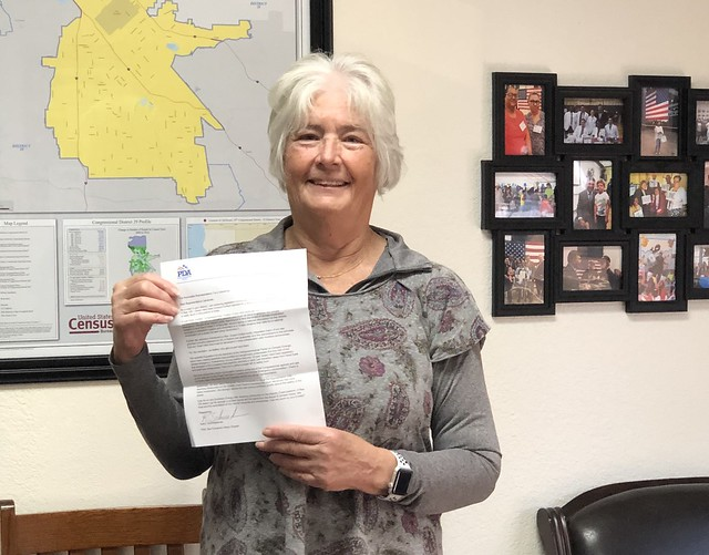 PDA's Kathy Schneiderman drops off PDA's Educate Congress letter for Rep. Tony Cardenas