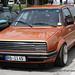 Orange VW Golf Mk2 with Oriciari headlamp covers