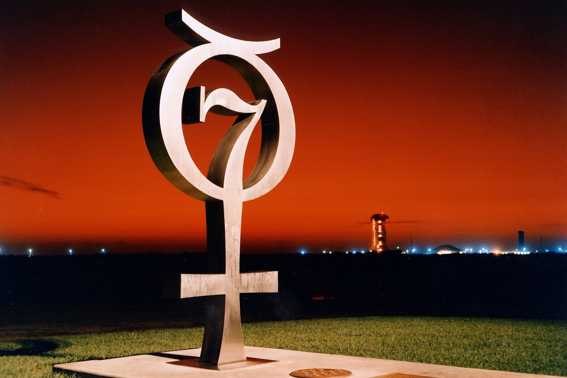 The Mercury Monument honoring the original seven astronauts is shown here at sunrise at Launch Complex 14. Photo taken on December 18, 1964.
