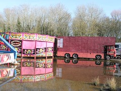 quicksilver coaches posted a photo:	Reflecting on the gradual disappearance of the traditional showman's special in favour of anonymous modern artic units. Hatwells' E465 MHW is a fine example of an eight-wheel luton used with an old-fashioned build-up wooden waltzer. This end of the ground seems to have drainage issues resulting in a huge puddle forming, fortunately behind the rides where the public wouldn't normally venture.